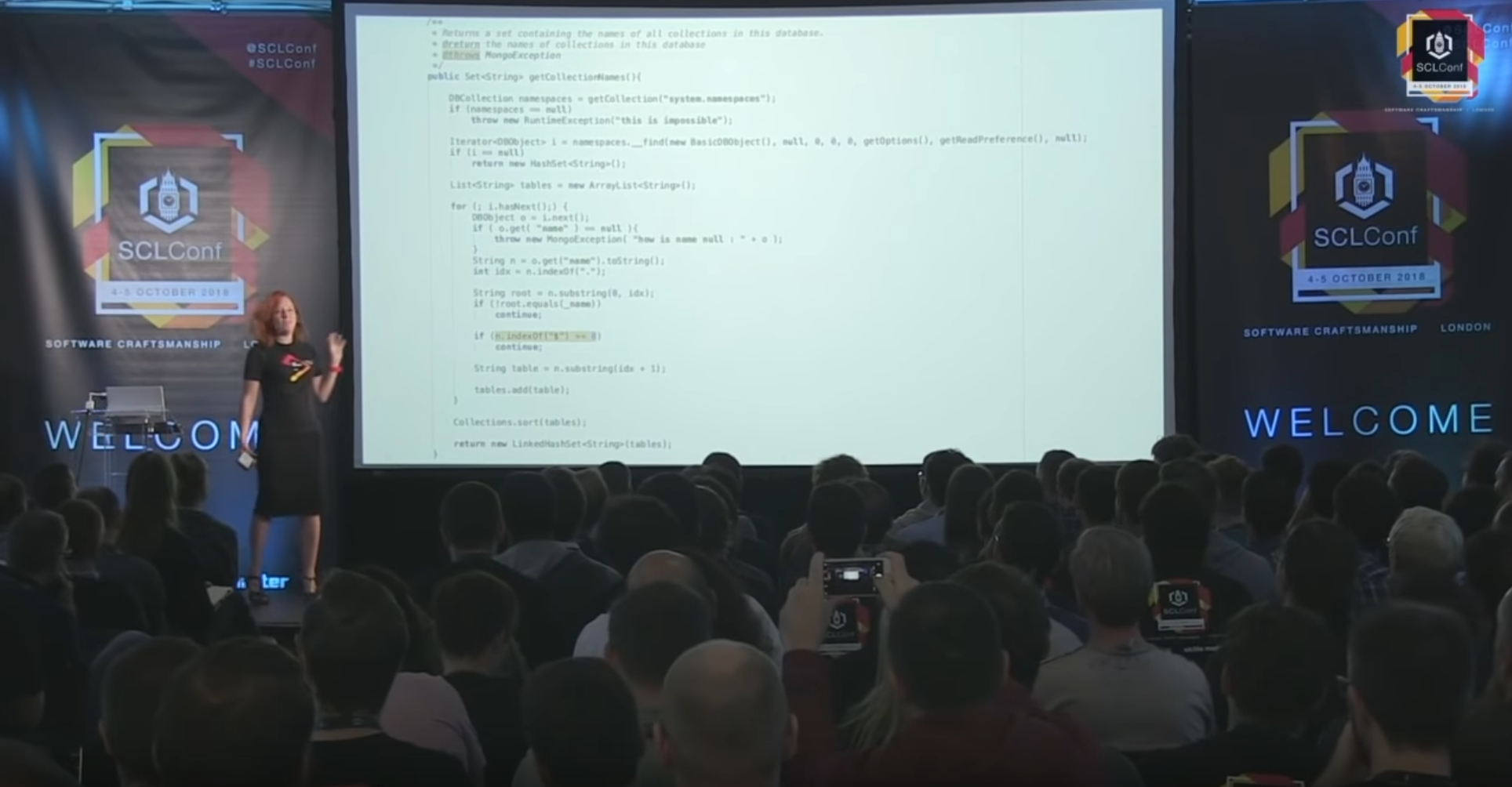Still of the presentation video; shows Trisha presenting against a backdrop of Java code